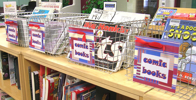 Comic books in baskets in a library; Photo CC BY Enokson via Flickr
